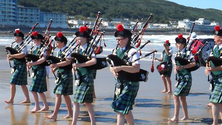 Bideford Youth Pipe Band playing in the sea at Westward Ho! over the bank holiday weekend.