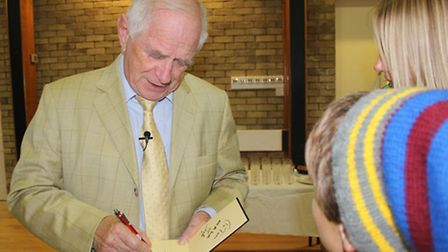 Johnny Ball signed autographs for his audience at Park Community School