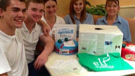 Staff at The Pelican draw the raffle on Thursday night.
