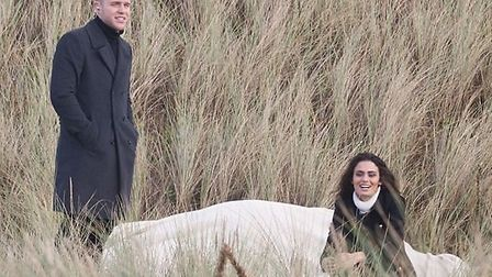Olly Murs with the mystery brunette filming on Saunton Sands. Pic: Andy Casey.