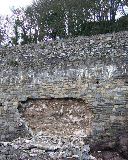 The damage caused to the stone facing of a harbour wall at Marine Drive in Ilfracombe.