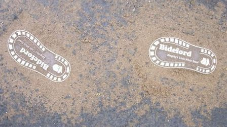 These footprints have been placed in East-the-Water - the sand is a temporary health and safety meas