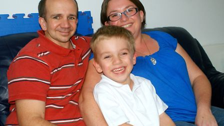 Battler: Six-year-old George Palmer, pictured here with mum and dad Nicki and Gary, is making great