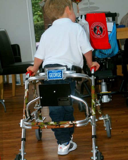 On the move: George Palmer is learning to walk after undergoing revolutionary surgery in America a y