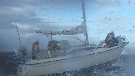 The yacht Kenja with crew members Ben Langham and Andy Day aboard during rough sea conditions. PHOTO
