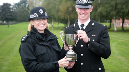 PC Lee Adamson from Barnstaple is presented with the regional dog trials trophy by Chief Inspector J