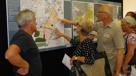 Local people are pictured looking at the plans at an exhibition last year.
