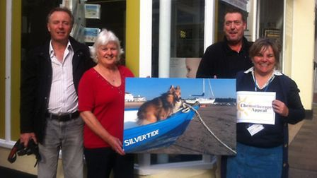 Pictured outside the Fotowrold Barnmstapel shop is Brenda Parsley, joined by photographer Graham Hob