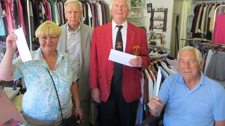 South Molton Rotary Club president Peter Hardwick presents fundraising cheques to Jane Kent of South