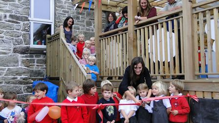 Foundation Stage Class teacher Faye Poynter has plenty of help as she officially opens the new combi