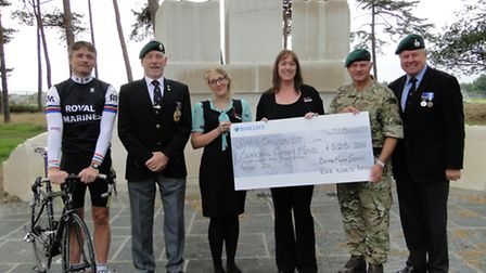 Presenting the cheque on site to Lieutenant Colonel Stuart Tulloch (second right) at the Memorial Ga