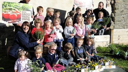 Pilton Pre-school youngsters get together to plant their new garden, joined by nursery assistant Liz