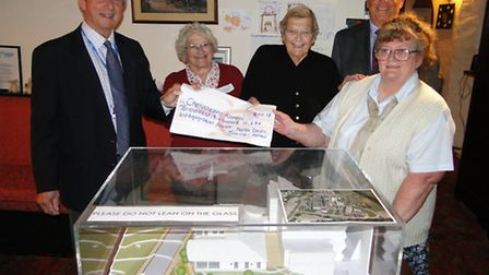 Carol McCormack presents the £10,600-plus left over after the people of North Devon raised £500,000