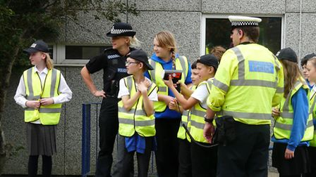 Police and Ilfracombe Junior School pupils with a speed gun outside their school during the road saf