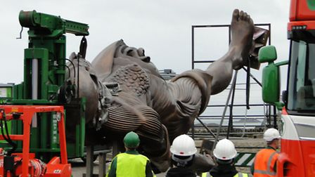 A year ago, it took an entire day for Damien Hirst's statue to be positioned.