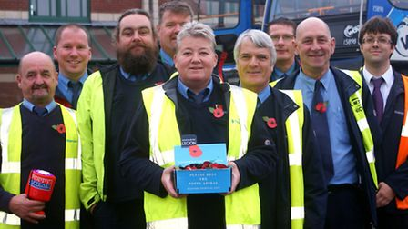 Stagecoach drivers are pictured with their poppies outside Barnstaple Bus Station.