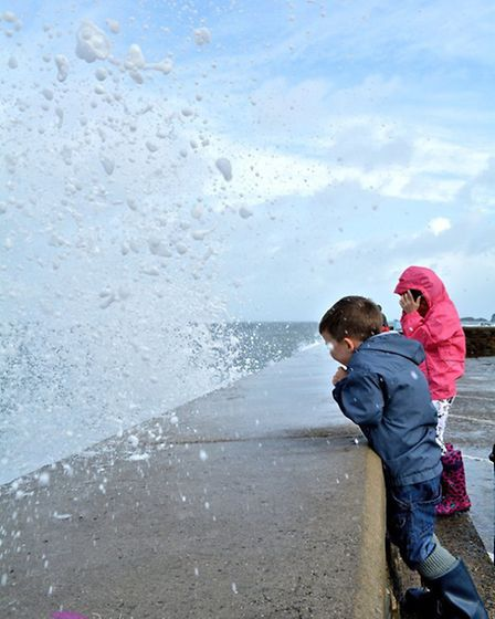 Watching the waves crash in at Ilfracombe on Sunday. Pic: Angela Pink.