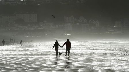 Walkers enjoy the bright conditions after the storm passes Westward Ho! on Monday morning. Picture b