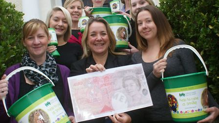 Members of Brewer Harding & Rowe's staff liaison group prepare for the £50 Challenge in aid of Child