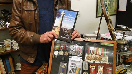 Ian Arnold with a copy of his book, The First World War Memorial Book of Bideford, and some of his m