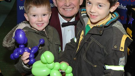 Oliver, 4, and Christopher, 6, are treated to some balloon modelling by Dave Hendy at St John's Gard