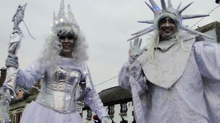 Stilt walkers at Bideford's light switch on entertain the crowds.