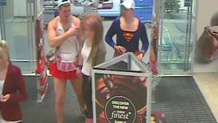 Police are looking to speak to the man on the left in connection with the theft of a coat.
