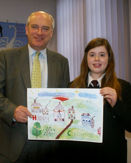 North Devon MP Nick Harvey is pictured with Christmas card competition winner Emily Dixon, from Sout