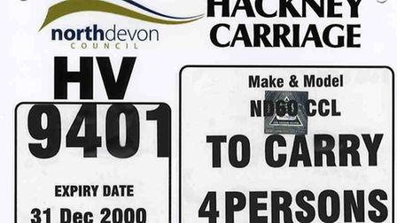 An example of a registration plate that can be found on a taxi licensed by North Devon Council.
