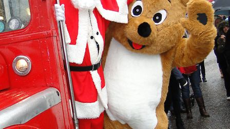 Santa and friends arrive by bus at last year's event. The grand old gentleman will be arriving at Tr