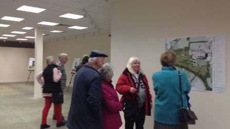 Residents discuss the plans at today's consultation.