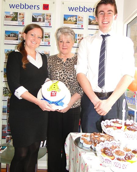 Staff at Webbers in Barnstaple holding a cake sale.