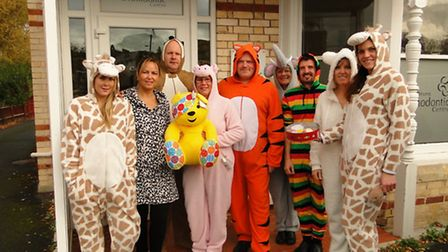 The team at North Devon Orthodontics dressed up in animal onesies and sold cakes on Friday.