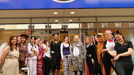 Boots staff donned their onesies, dressed as Puss in 'Boots' and wore their pyjamas to work.