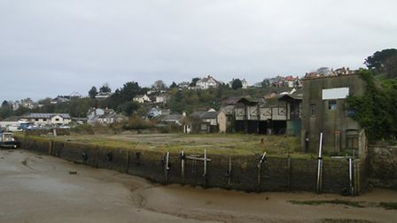How it is now: The wharves currently harbour derelict buildings and a car park.