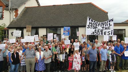 Local people make their feelings known at a rally opposing the changes held in July.