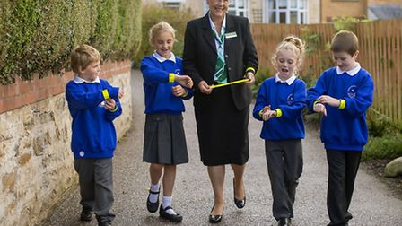 Pupils of Combe Martin Primary School, pictured with their new reflective wristbands, to help them w