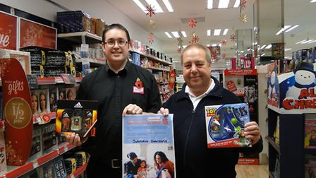 Barnstaple Superdrug manager Simon Sloman with Salvation Army Captain Vincent Wall launching the Chr