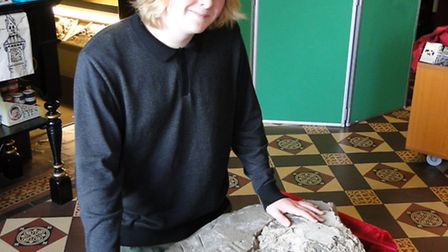 Jack Lawrence, 14, with the stone he found at West Down.