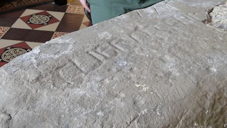 The inscription on the stone reads 'Guerngen' and is believed to possibly have been a pillow stone p