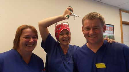 Ready for 'the snip': Theatre staff nurse Anne Fulford, nursing auxiliary Dawn Wright and deputy the