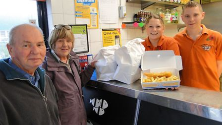 Whiddon Fryer staff Heather Dennis and Aaron Cooper serve a job lot of fish 'n' chips for Mill Court