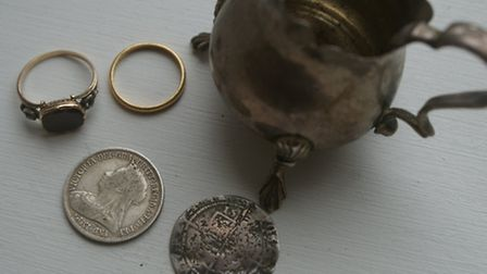 The small hoard of personal treasures discovered in the kitchen wall of the former bank vault at Sta