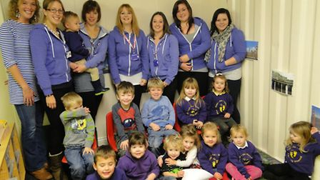 Stepping Stones Pre-school staff and children celebrate their good Ofsted report.