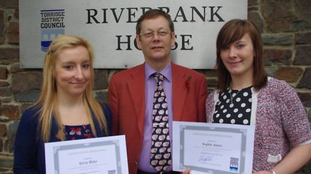 Cllr Philip Collins with Kirsty Blake and Sophie Amos holding their apprenticeship completion certif