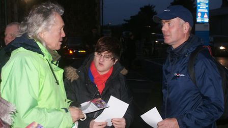 Green Party member Ricky Knight (left) spoke to a number of commuters, including Peggy Johnson and D