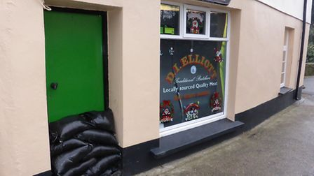 Pumps and sandbags helped keep flood water at bay outside DI Elliott butchers in Bishops Tawton this