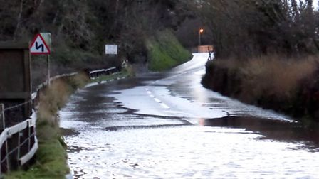 The B3233 at Wesleigh is closed due to flooding.