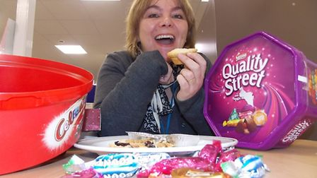 Chemo Appeal fund raiser Julie Whitton mops up the last mince pies and Christmas sweets before getti