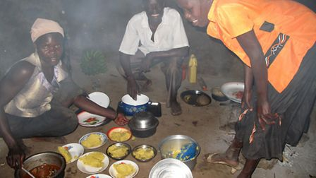 The family cook the dinner in a small, smoke-filled hut.